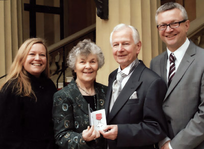 Brian Jones, pictured with family, proudly displays his MBE.