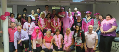 Michelle Cartwright, Pink Lady extraordinaire, and the staff at the laboratory at the Birmingham Assay Office in the pink. During the week Michelle also organised a Cake Sales and a pink themed quiz.