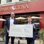 Damascena makes £8K donation to Acorns Children's Hospice